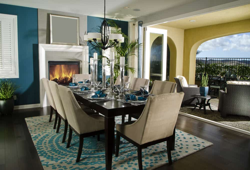 Beautiful dining area with table and rug