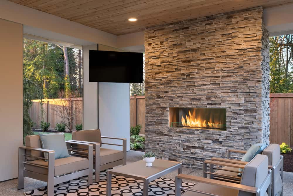 Luxury outdoor living room with TV and fireplace
