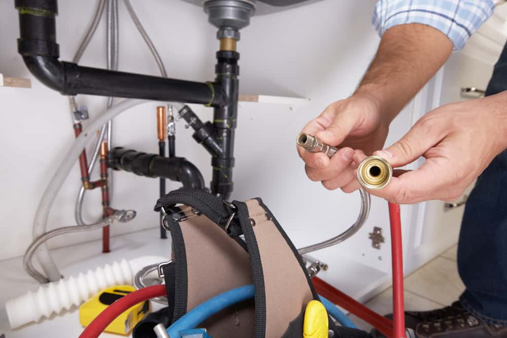 plumber with plumping tools