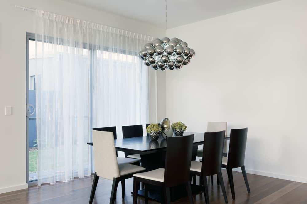 Stylish dining area with chandelier