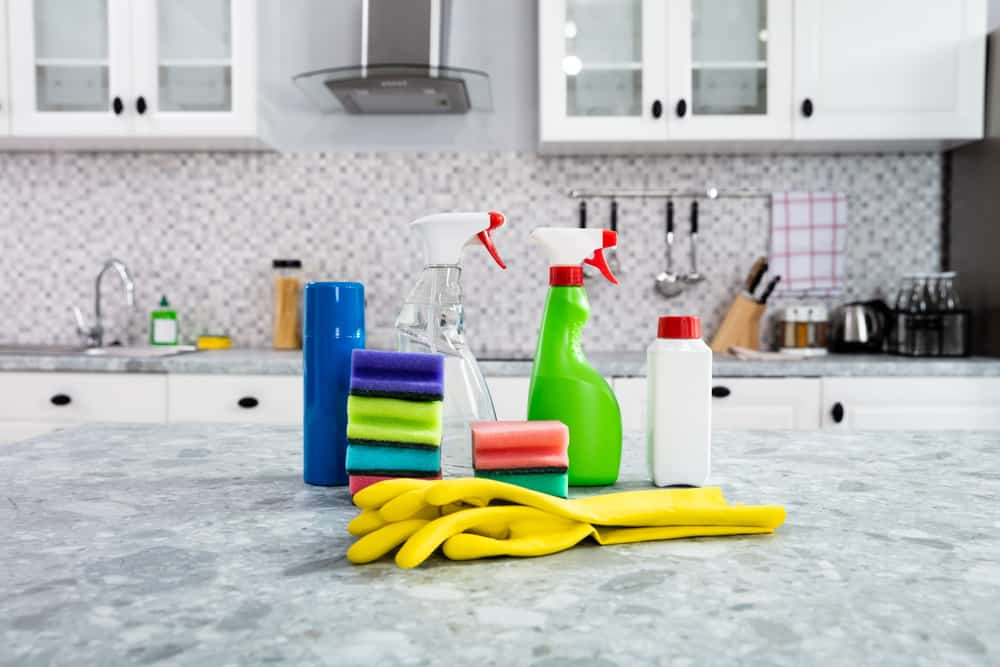 cleaning supplies on a kitchen countertop
