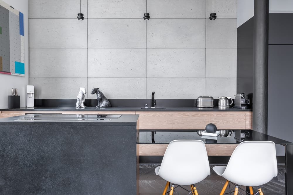 modern kitchen with black table and white chairs