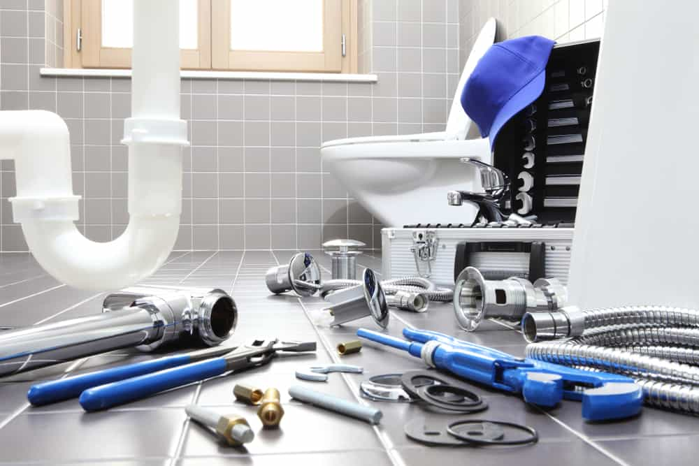 plumber tools and equipment in a bathroom