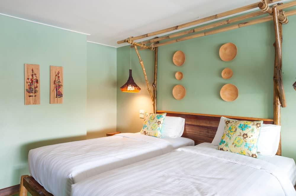 green bedroom with two beds