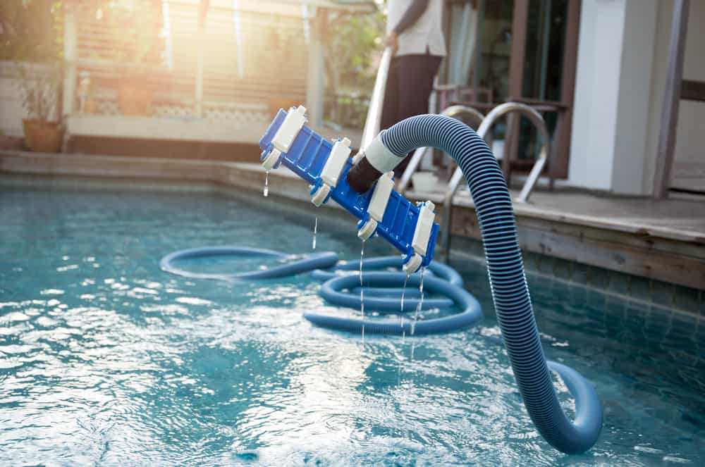 cleaning a pool with a vacuum tube cleaner